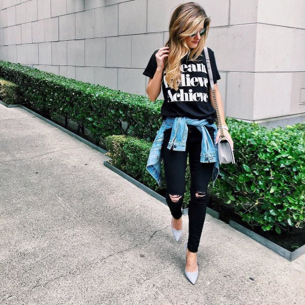 black printed t-shirt with ripped jeans and denim jacket tied around the waist