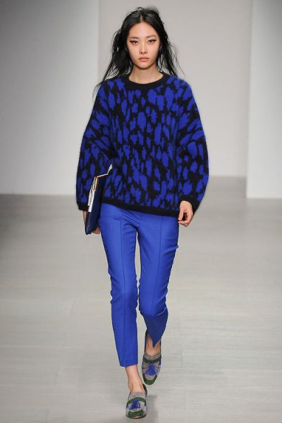 black printed knitted sweater with royal blue wax trousers and graphic evening shoes