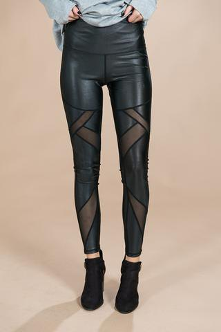 black printed, semi-transparent leather gaiters with light gray long-sleeved T-shirt
