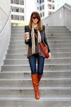 black puffed shoulder leather jacket with dark blue jeans and boots