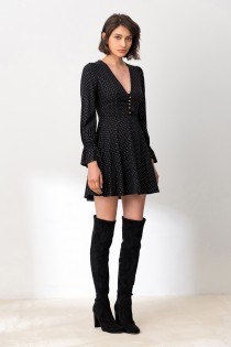black skater mini dress with puff sleeves and overknee boots