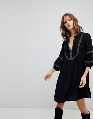 black smock boots with puff sleeves