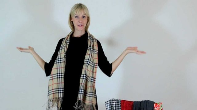 black sweater with mini skirt and red checked pashmina scarf