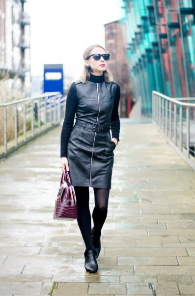 black sweater with faux leather dress with zipper in front