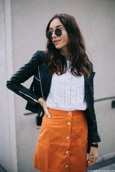 black quilted leather jacket with orange suede skirt