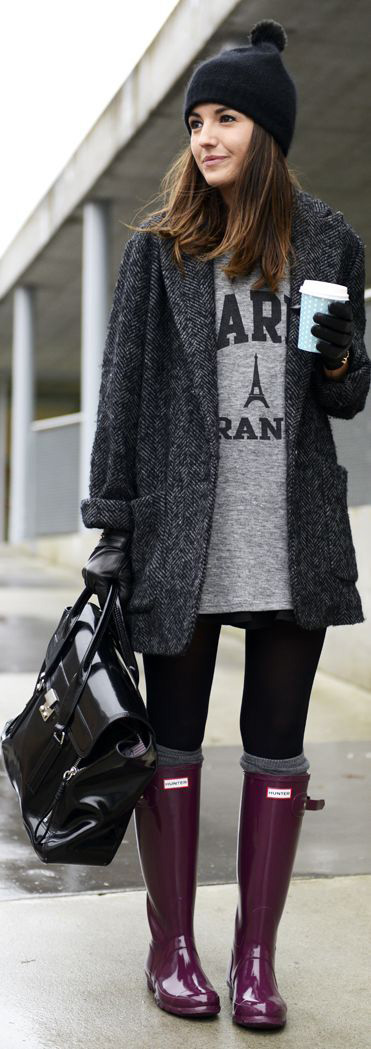 black rain boots with gray coat