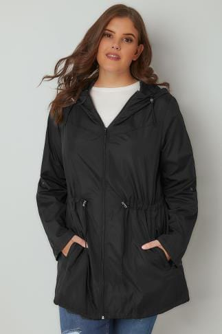 black parka jacket with relaxed fit, sweater with round neck and blue jeans