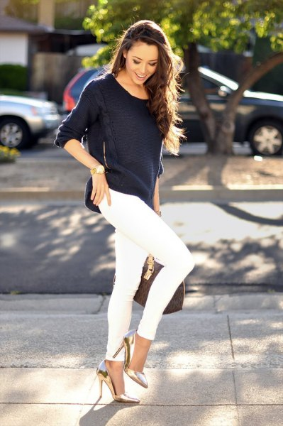 black sweater with relaxed fit and white skinny jeans