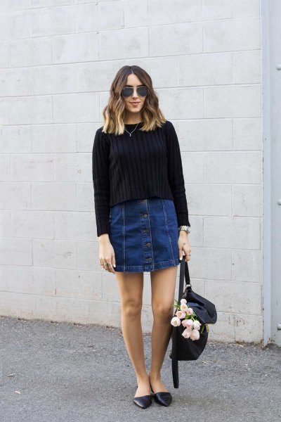 black ribbed knit sweater with dark blue denim mini skirt with button placket