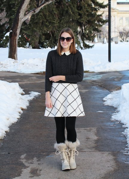 black ribbed sweater with a white printed skater skirt
