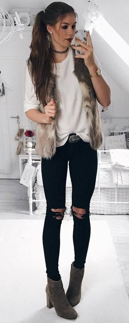 trendy outfit / fur jacket + top + black ripped jeans + boots .