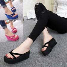 black, ripped skinny jeans with flip-flop heels