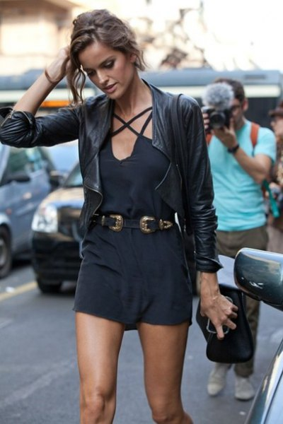 black romper suit with cowboy belt and leather jacket