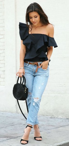 black strapless blouse with ruffle shoulder and light blue slim fit jeans