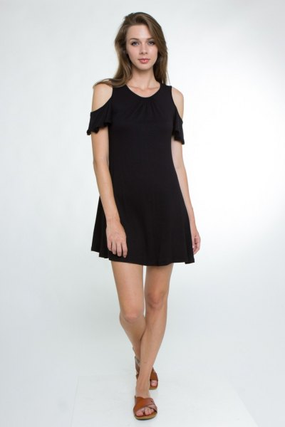 black swing dress with cold shoulders and ruffle sleeves
