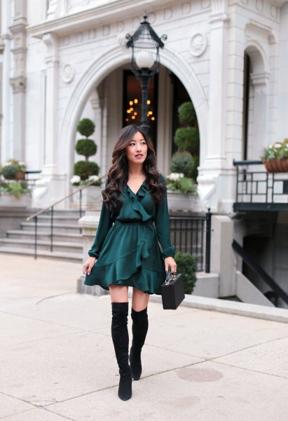 black blouse with V-neckline with ruffles, matching skater skirt and flat over-the-knee boots