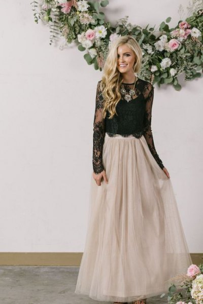 black lace top with scalloped hem and floor-length skirt made of light pink tulle