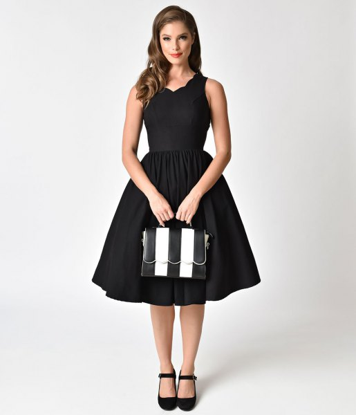 black swing dress with scalloped neckline in the style of the 1950s