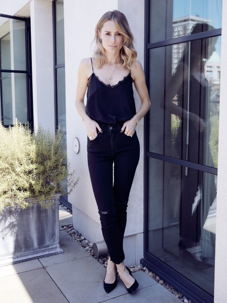 black camisole with scalloped neckline and skinny jeans