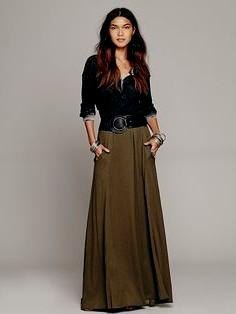 black blouse with scoop neckline and green maxi skirt with belt
