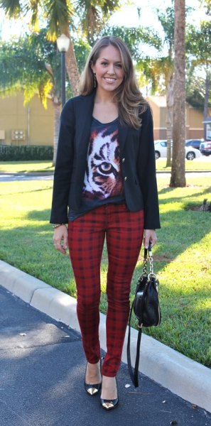 black graphic t-shirt with scoop neckline, casual blazer and red checked pants