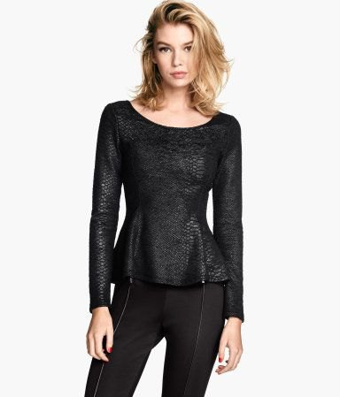 long peplum top made of black leather with a scoop neckline