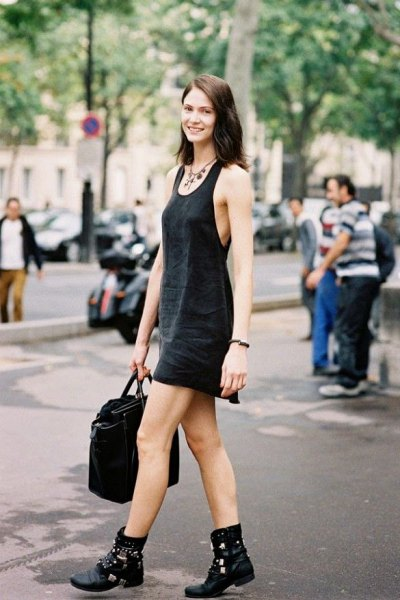 black mini tank sheath dress with scoop neckline and biker leather boots