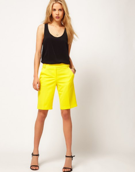 black sleeveless tank top with scoop neckline and yellow shorts