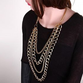 black sweater with scoop neckline and eye-catching gold chain