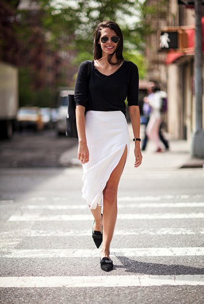 black sweater with scoop neckline with white midi slit and pointed toe shoes