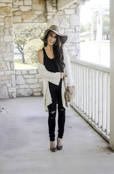 black tank top with scoop neck, white cardigan and floppy cap