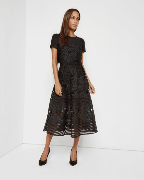 black, semi-transparent midi dress made of floral lace