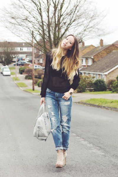 black semitransparent sweater with torn jeans and gray ankle boots