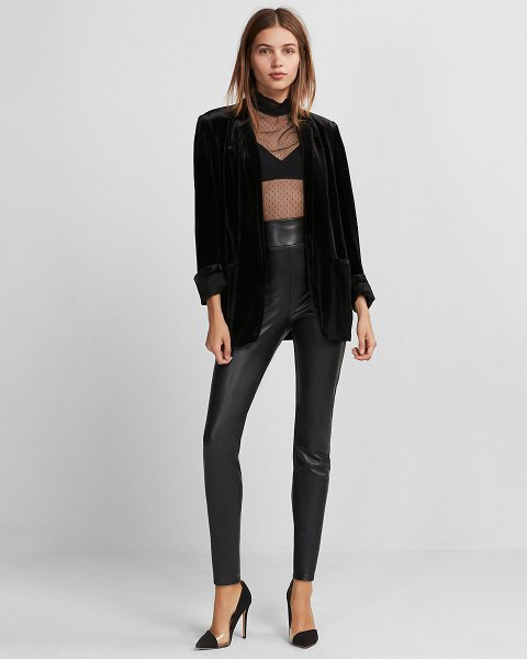 black, semi-transparent top with high leather gaiters and blazer