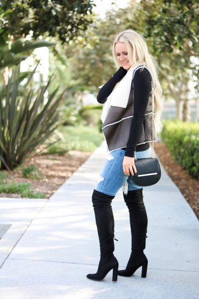 black shearling leather vest with denim shorts and overknee boots