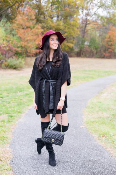 black poncho with belt and belt