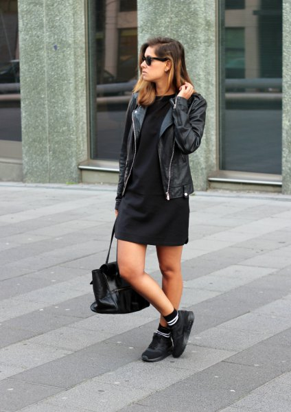 black shift mini dress with moto jacket and hiking boots