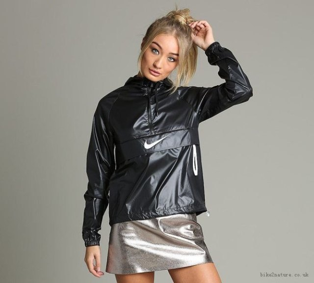 shiny black windbreaker with silver mini skirt