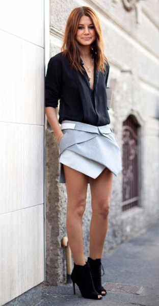 black shirt with gray skort and ankle boots
