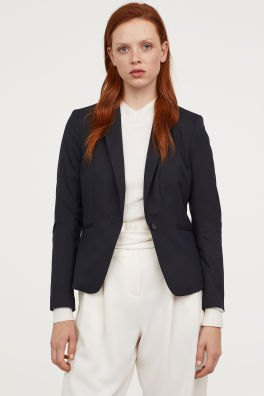black short and tailored blazer with white high-rise pants with a relaxed fit