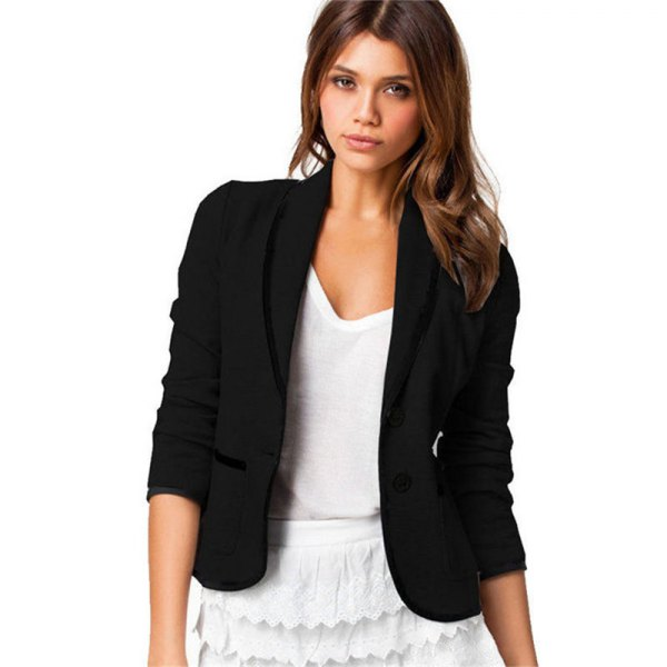 black, short-cut cotton blazer with a white miniskirt with a scalloped edge