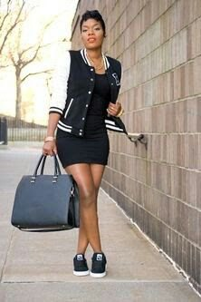 black, short-sleeved, figure-hugging mini dress and canvas sneakers