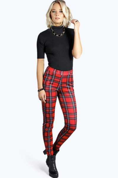 black short-sleeved sweater with mock neck and red checked trousers