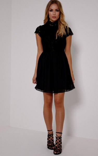 black short-sleeved tulle dress with a high neck