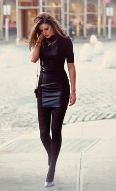 black, short-sleeved, figure-hugging mini dress made of synthetic leather with leggings