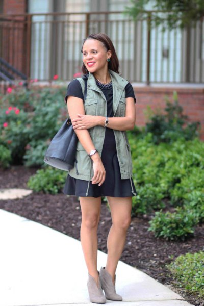 black short-sleeved T-shirt with matching skater skirt and military vest