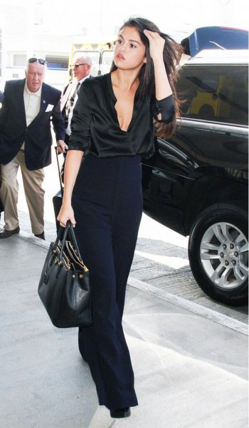 black silk shirt with buttons and dark blue trousers with wide legs