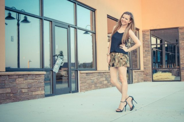 black silk vest top with flowing camo mini shorts