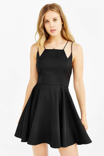black skater dresses additional straps on the shoulders