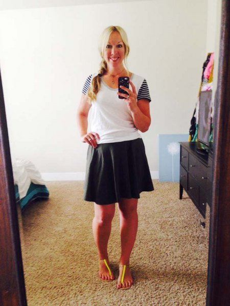 black skater skirt and white t-shirt with scoop neckline and striped sleeves